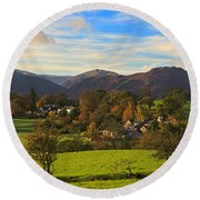 The Village Of Watermillock In Cumbria Uk Round Beach Towel