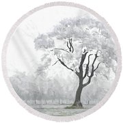 The Winter's Embrace Round Beach Towel
