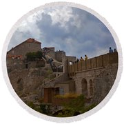 They Walk The Wall In Dubrovnik Round Beach Towel