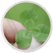 Three Leaf Clover In A Hand Round Beach Towel