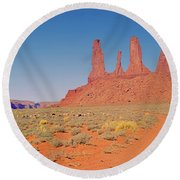 Three Sisters And Grazing Sheep Round Beach Towel