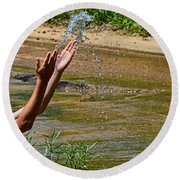 Throwing Water I Round Beach Towel
