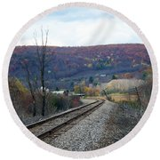 Tracks In The Valley Round Beach Towel