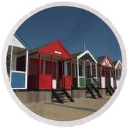 Traditional Beach Huts On The Seafront Round Beach Towel