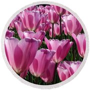 A Field Of Translucent Tulips Round Beach Towel