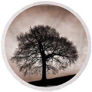 Tree Against A Stormy Sky Round Beach Towel