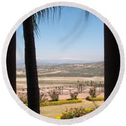 Tree Blocking View Of Garden And Valley And Ice-capped Mountains Round Beach Towel