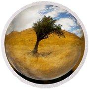 Tree In A Field Through A Glass Eye Round Beach Towel