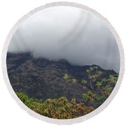 Trees And Leaves At The Base Of A Mountain With Clouds And Mist Covering The Top Round Beach Towel