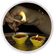 Trying To Light An Oil Lamp That Has Gone Out Round Beach Towel