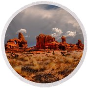 Turret Arch And Storm Clouds Round Beach Towel