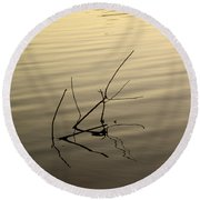 Twigs Breaking The Calm Surface Of The Lake On Sunset Round Beach Towel