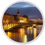 Twilight Over River Seine And Conciergerie Round Beach Towel