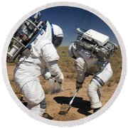 Two Astronauts Collect Soil Samples Round Beach Towel by Stocktrek Images