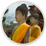 Two Buddha Statues Wrapped In An Orange Scarf  Round Beach Towel