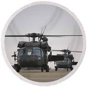Two Uh-60 Black Hawks Taxi Round Beach Towel