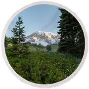 Upon A Hill Of Flowers Round Beach Towel