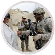 U.s. Army Soldier Shakes Hands With An Round Beach Towel