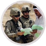 U.s. Army Soldiers Talking With A Town Round Beach Towel by Stocktrek Images