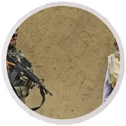 U.s. Army Specialist Talks To An Afghan Round Beach Towel by Stocktrek Images