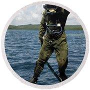 U.s. Navy Diver Jumps Off A Dive Round Beach Towel