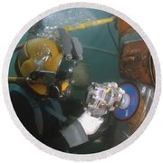 U.s. Navy Diver Uses A Grinder To File Round Beach Towel by Stocktrek Images