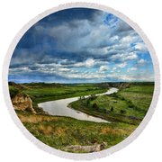 View Of River With Storm Clouds Round Beach Towel