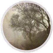 Vigilants Trees In The Misty Road Round Beach Towel