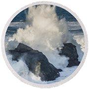 Wave Meets Seastack Round Beach Towel