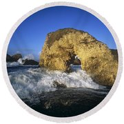 Wave Splashing Against Natural Arch Round Beach Towel