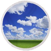 White Clouds In The Sky And Green Meadow Round Beach Towel