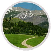 Windy Road To The Crazy Mountains Round Beach Towel