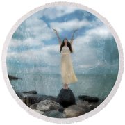Woman By The Sea With Arms Reaching Up In Praise Round Beach Towel