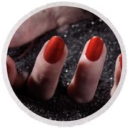 Woman Hand With Red Nail Polish Buried In Black Sand Round Beach Towel