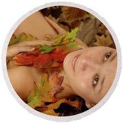 Woman In Fallen Leaves Round Beach Towel by Oleksiy Maksymenko