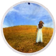 Woman In Field Looking Up At An Airplane Round Beach Towel