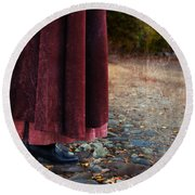 Woman In Vintage Clothing On Cobbled Street Round Beach Towel