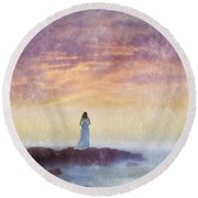 Woman In Vintage Dress At The Rocky Shore At Dawn Round Beach Towel