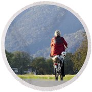 Woman On A Bicycle With Her Dog Round Beach Towel
