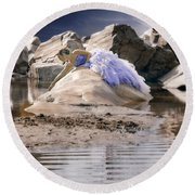 Woman On A Rock Round Beach Towel
