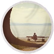 Woman On The Shore Of A Lake Round Beach Towel