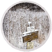 Wooden Sign In Winter By The Yankee Springs Recreation Area In Michigan Round Beach Towel