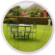 Wrought Metal Chairs Around A Table In A Lawn Round Beach Towel