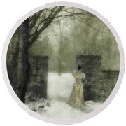 Young Lady By Stone Pillar In Snow Round Beach Towel