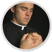 Young Priest Praying With Rosery Round Beach Towel
