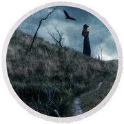 Young Woman On Creepy Path With Black Birds Overhead Round Beach Towel