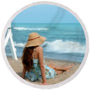 Young Woman Sitting On A Beach Round Beach Towel