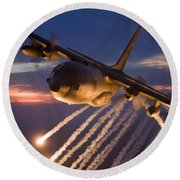 A C-130 Hercules Releases Flares Round Beach Towel