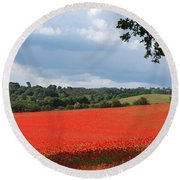 A Field Of Red Poppies Round Beach Towel