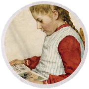 A Girl Looking At A Book Round Beach Towel